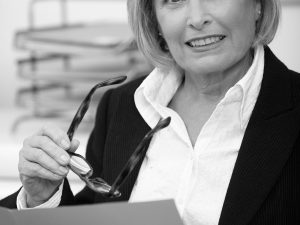 Senior businesswoman studying proposal